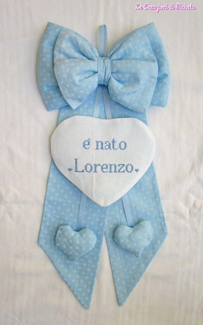 fiocco nascita celeste con cuori pendenti per Lorenzo